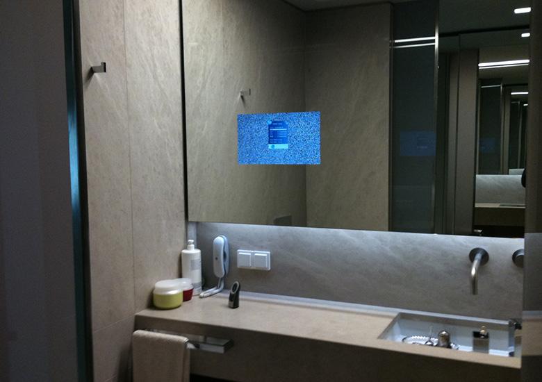 mirror tv bathroom