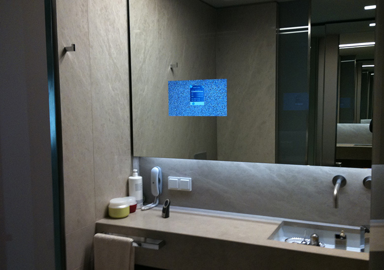 mirror tv bathroom