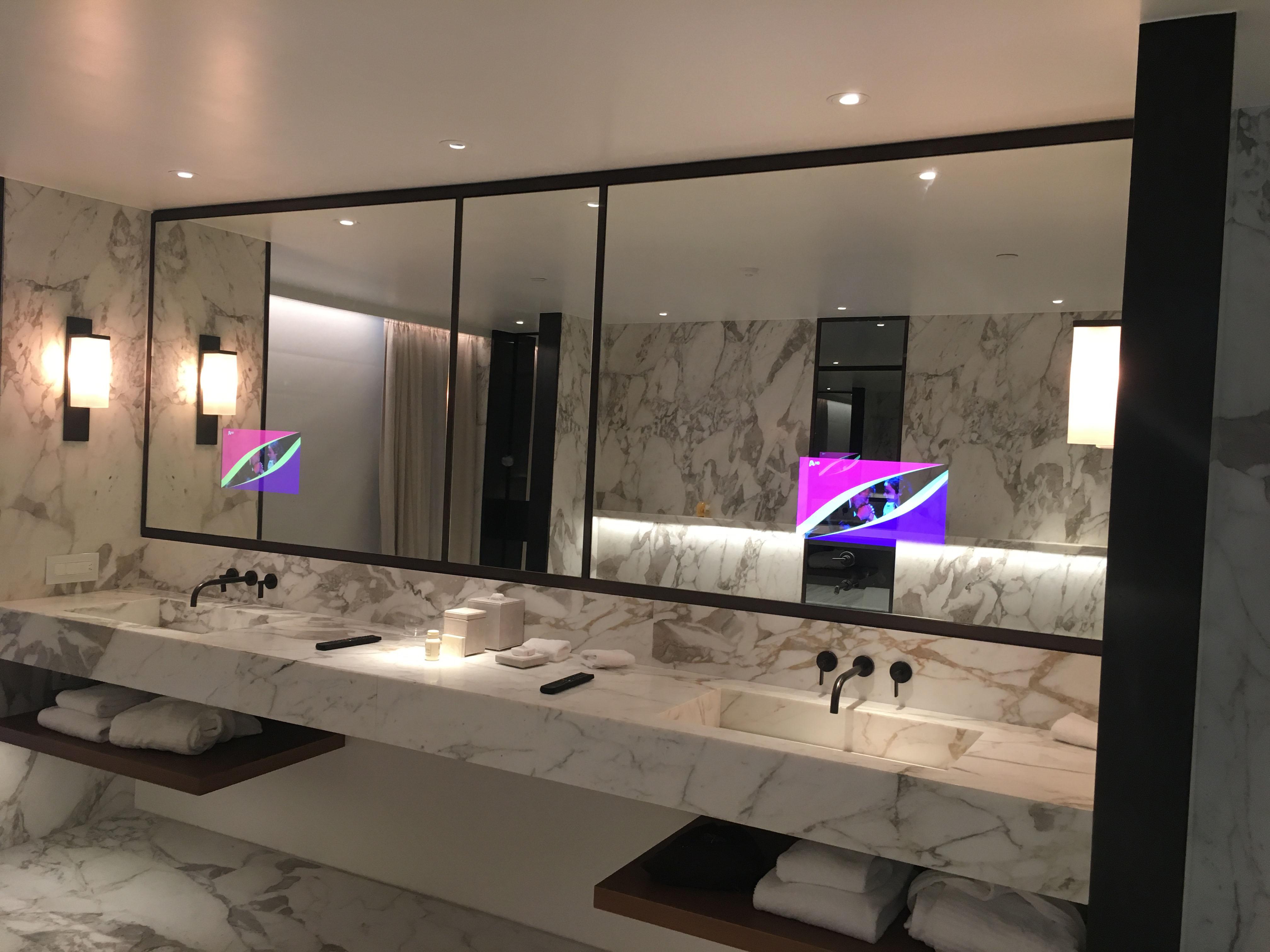 mirror tv hotel bathroom